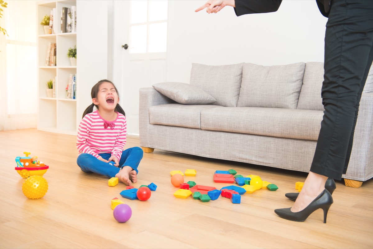 mom telling crying child to clean her room