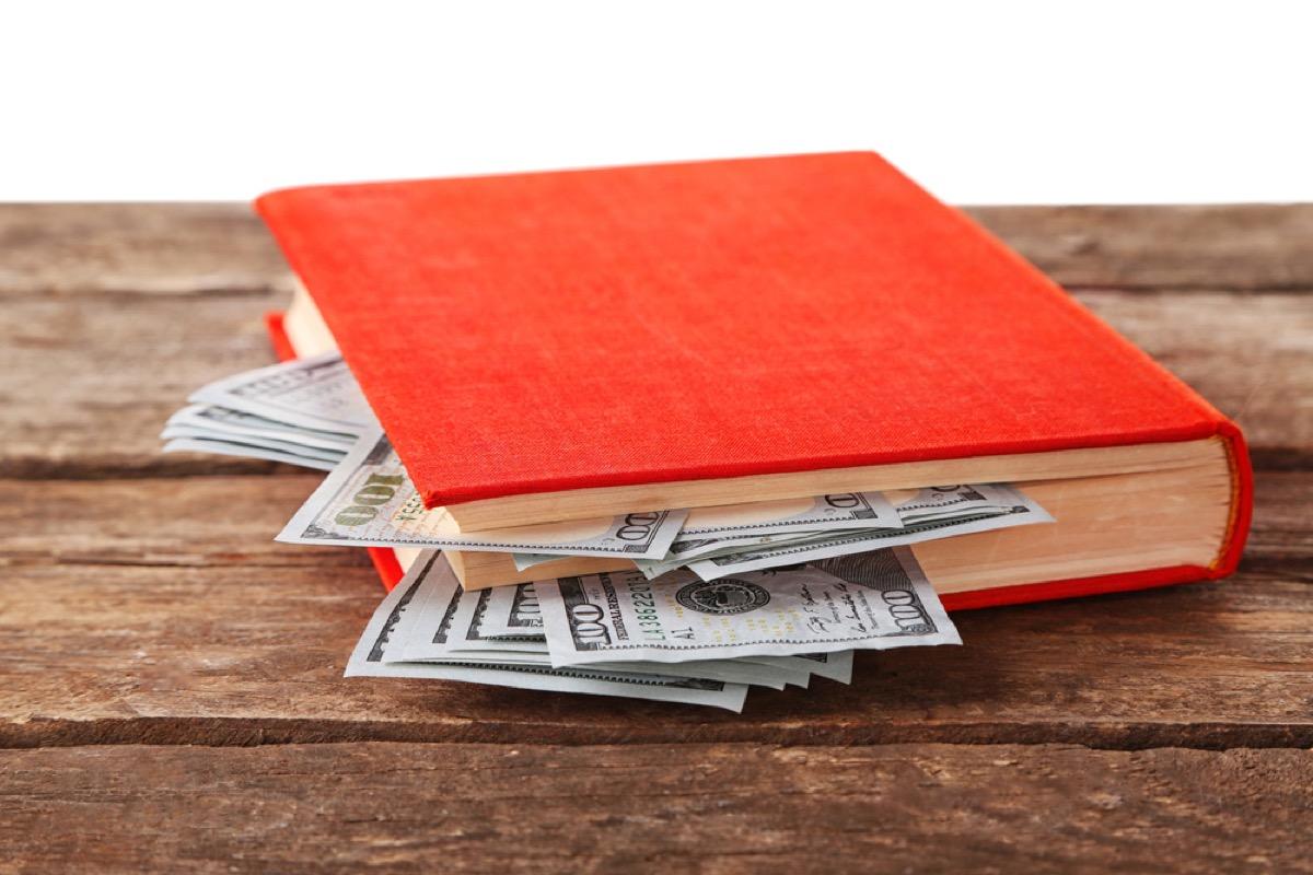 dollar bills in red book