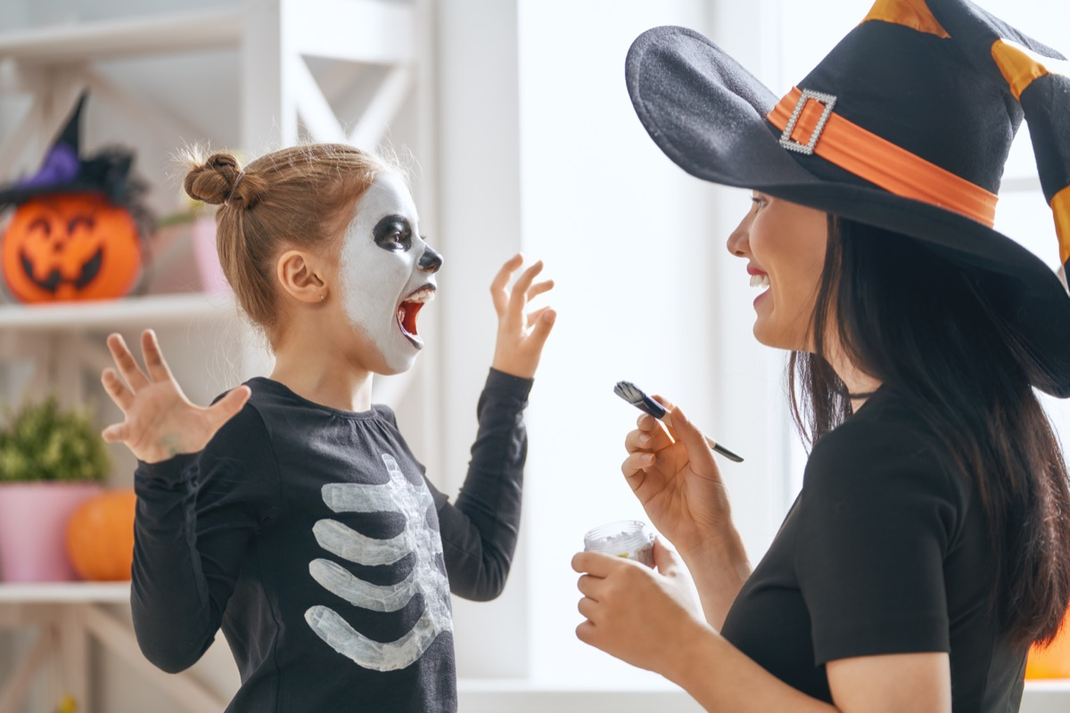 daughter laughing at halloween jokes and pun from a family