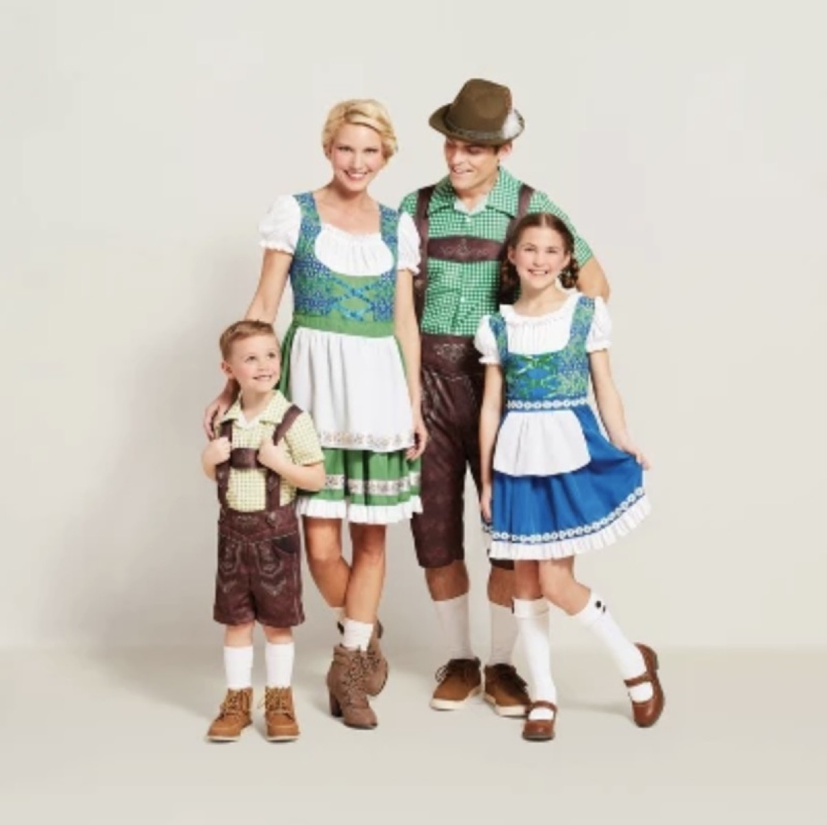 man, woman, and two children dressed in traditional german costumes, family halloween costumes