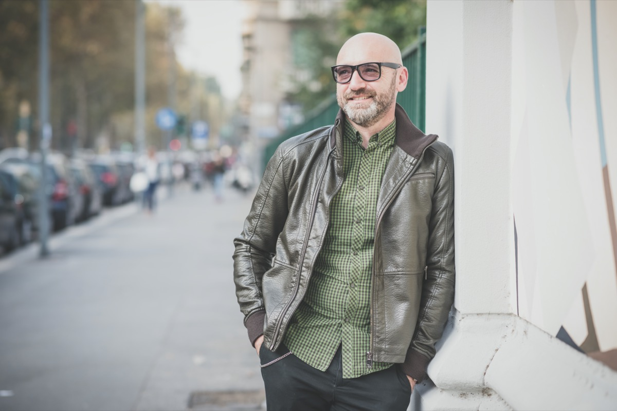 middle aged white man wearing green leather jacket