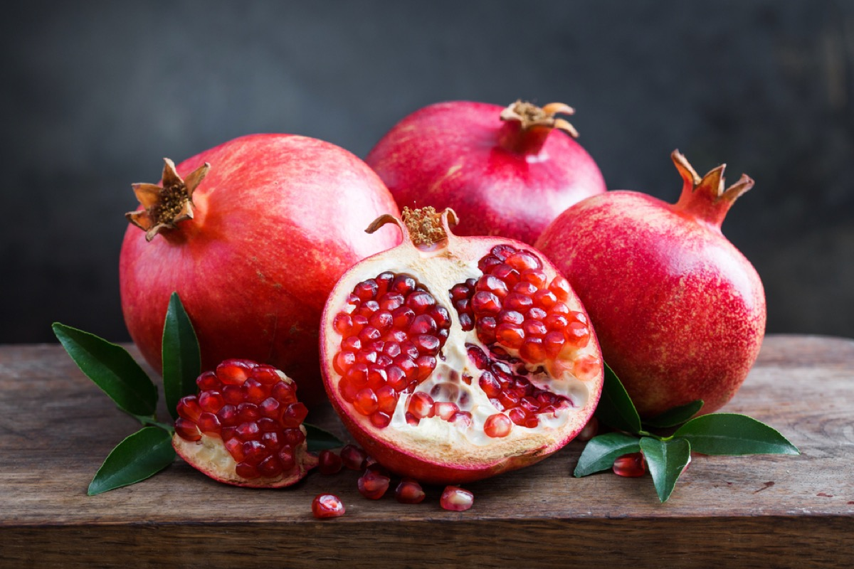 pomegranates on wooden table, rosh hashanah facts