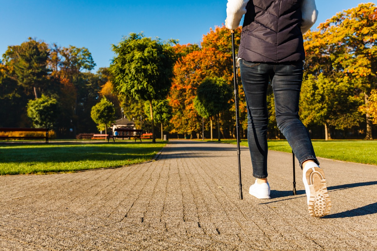 A woman power walking at the park