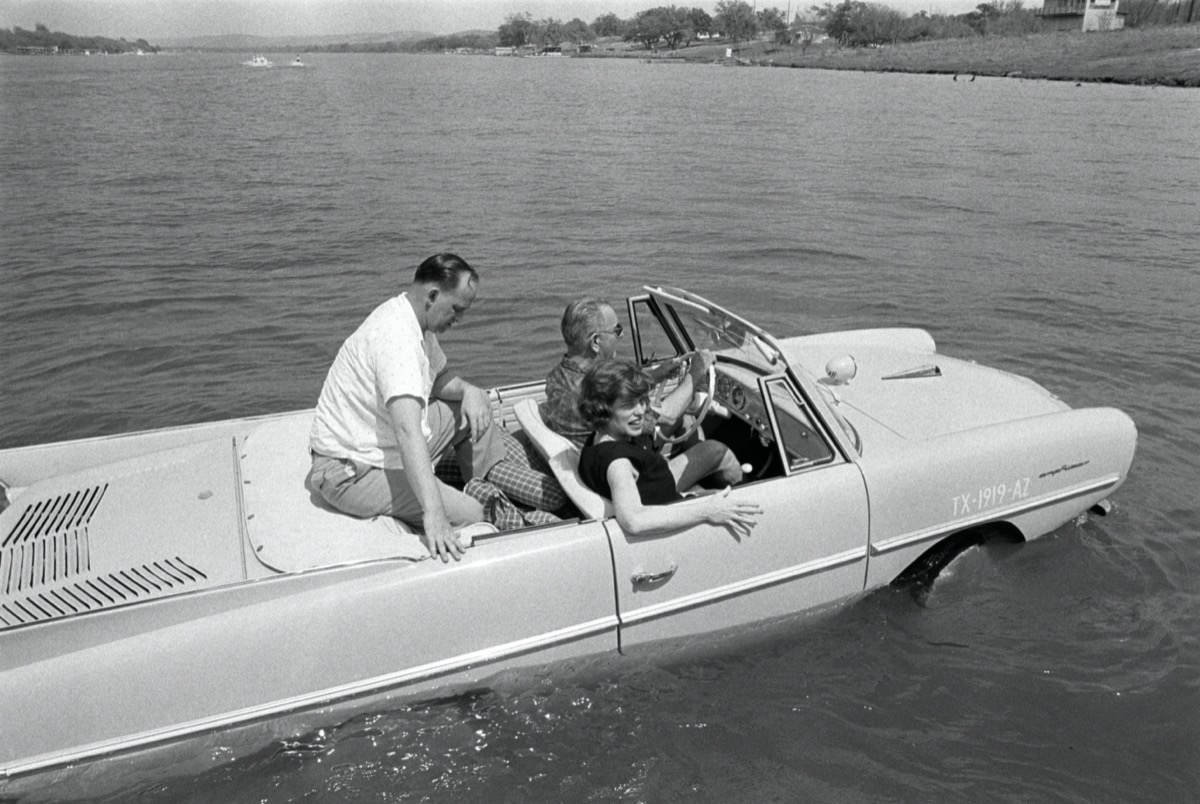 President Lyndon B. Johnson drives his Amphicar with Eunice Kennedy Shriver and Paul Glynn at the Haywood Ranch