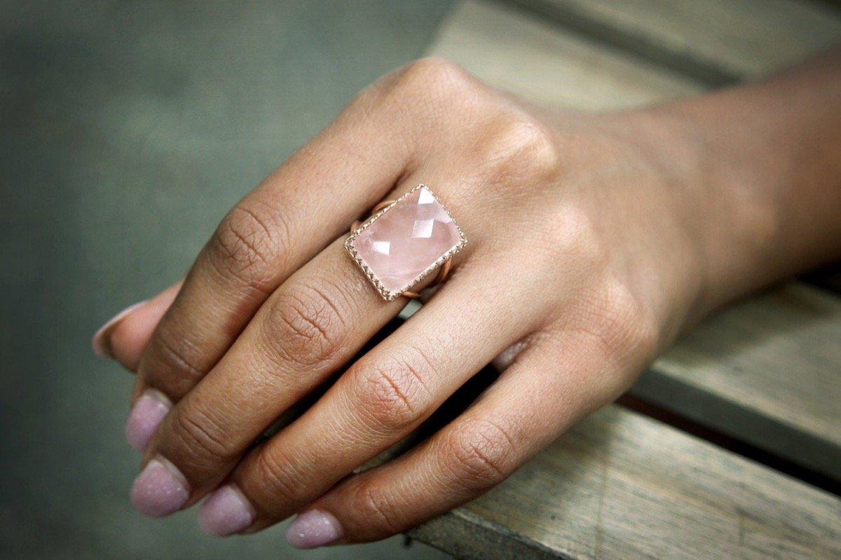 woman's hand with pink nail polish and large rectangular pink stone, Etsy jewelry