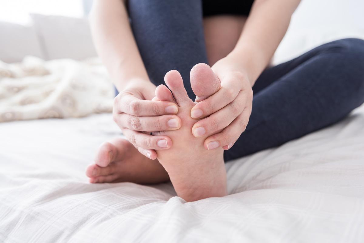 rubbing feet
