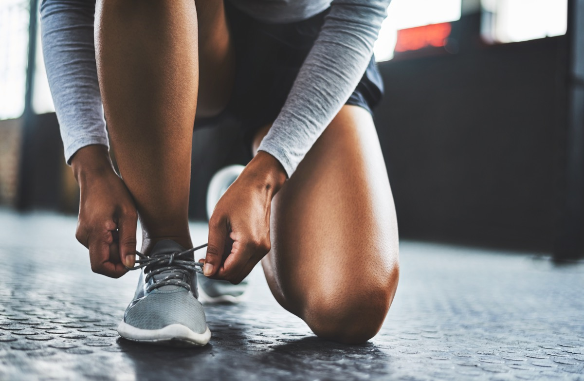 woman tying her running shoes, NASA every items