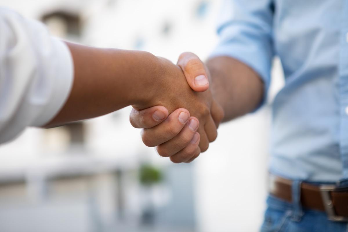 closeup on handshake between two men