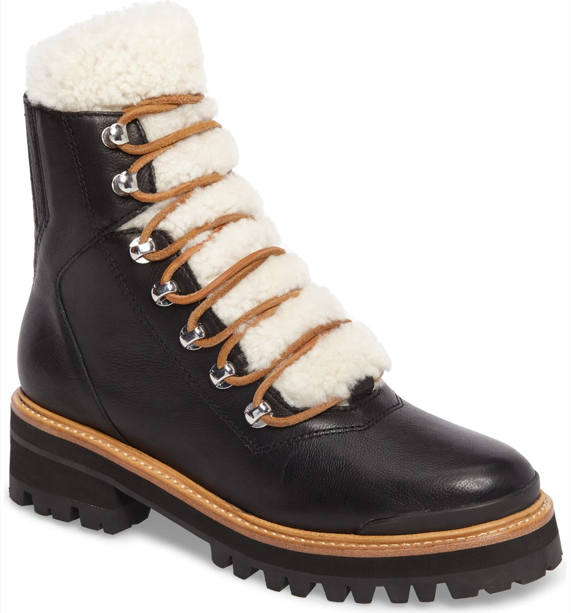 black lace up boots with white shearling tongue