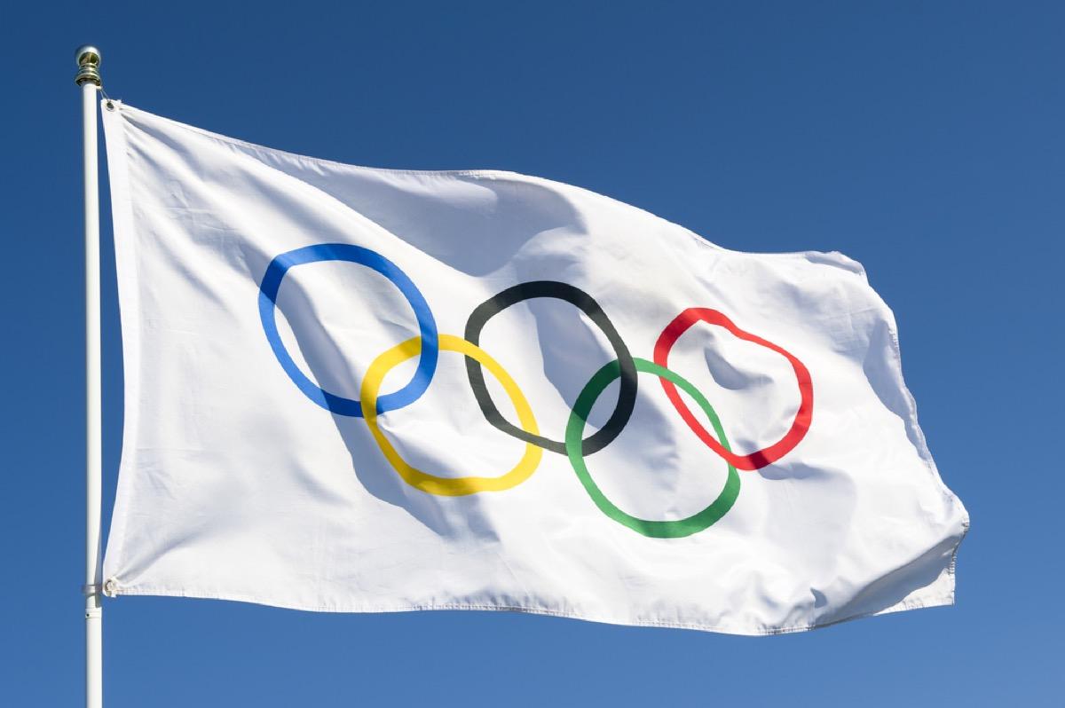 Olympic flag flying on flag pole