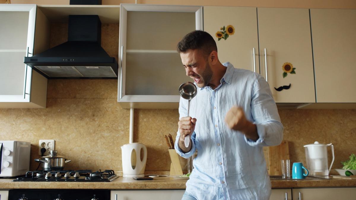 singing man in kitchen