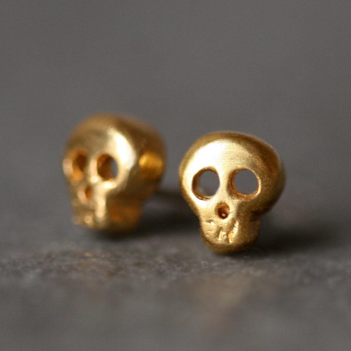 two gold skull earrings, Etsy jewelry