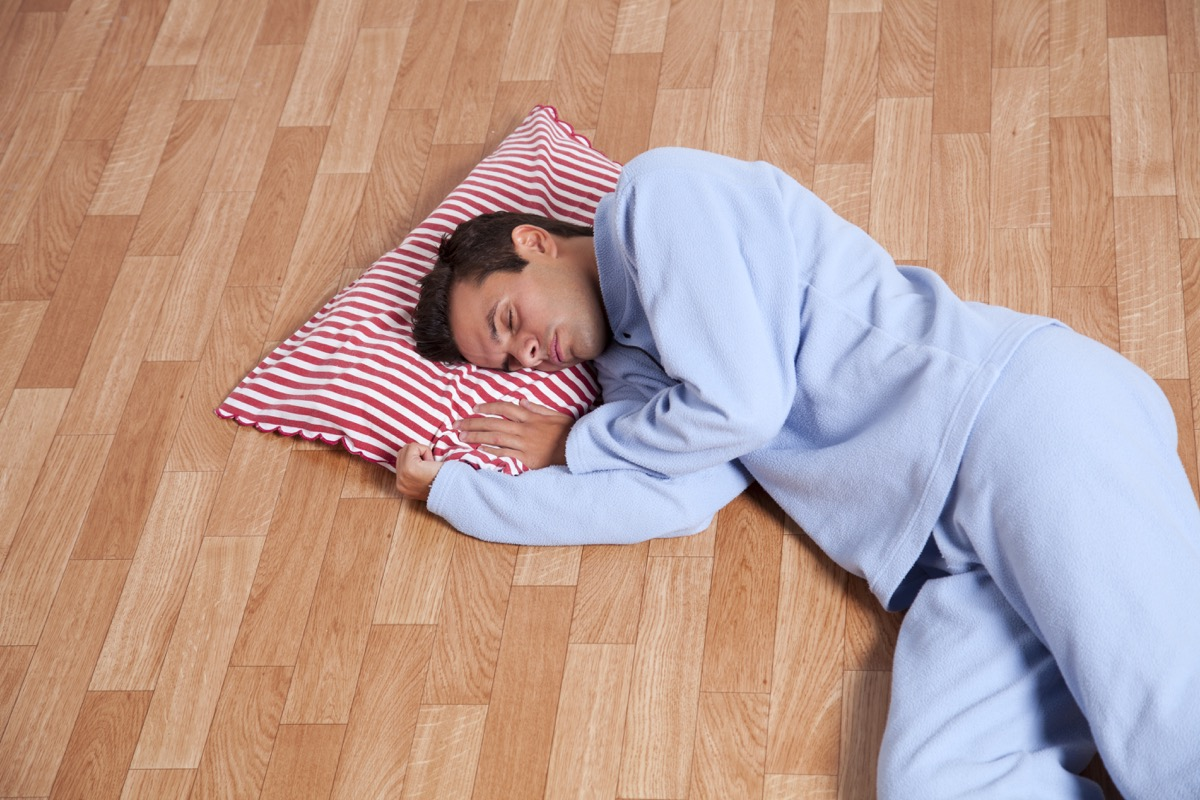man sleeping on the floor