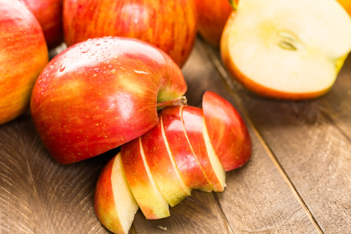 sliced apples on wooden table, rosh hashanah facts