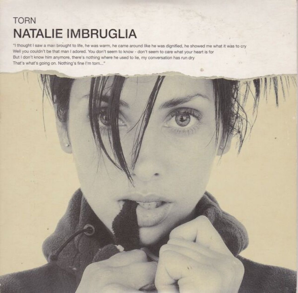 torn album cover from Natalie Imbruglia