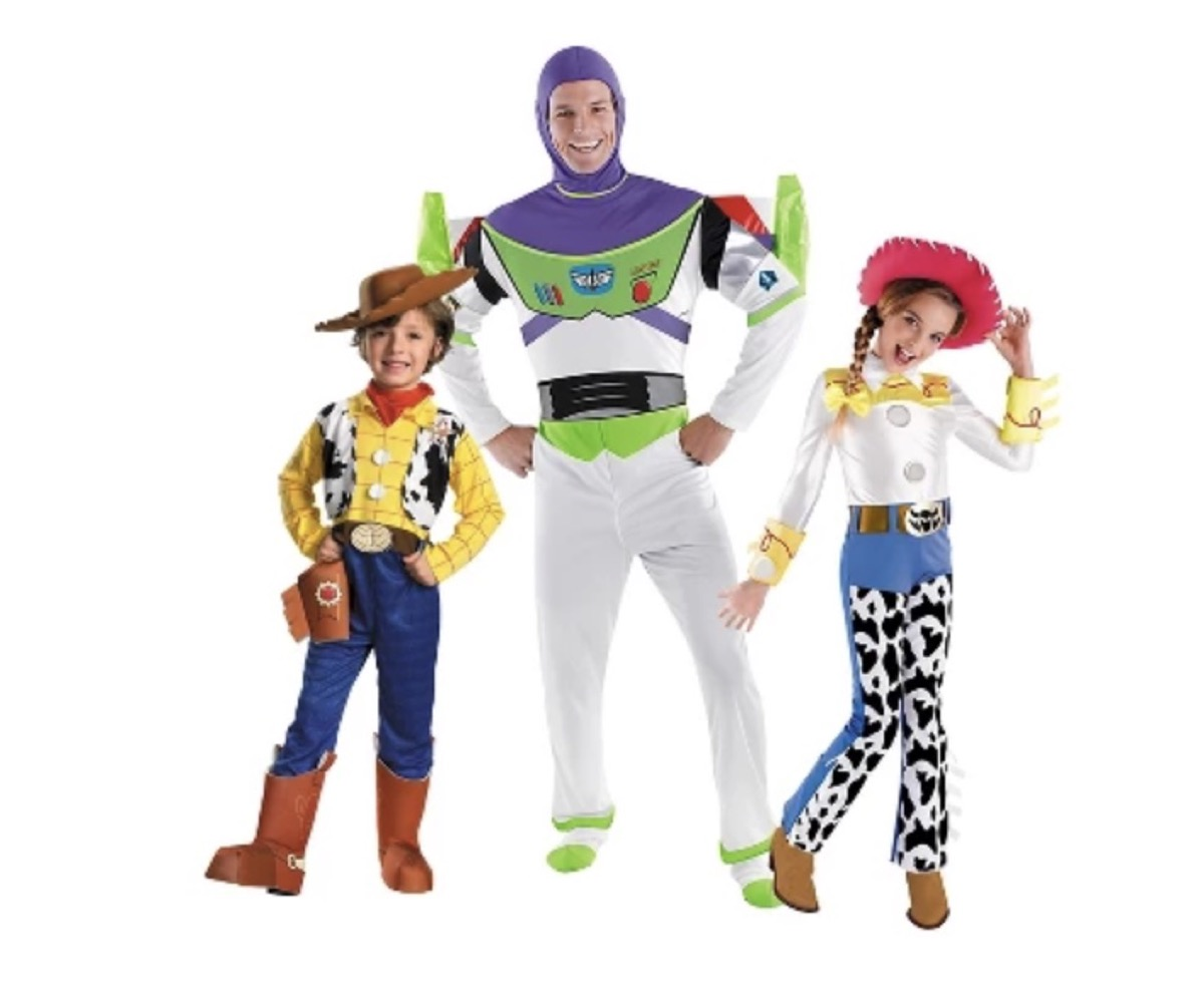 two children and adult man dressed as Toy Story characters, family halloween costumes