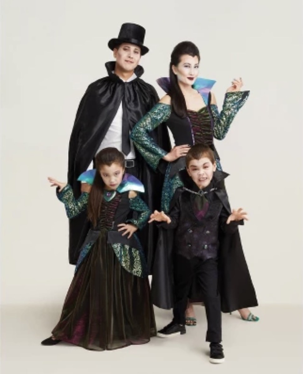 man, woman, and two small children dressed as vampires, family halloween costumes