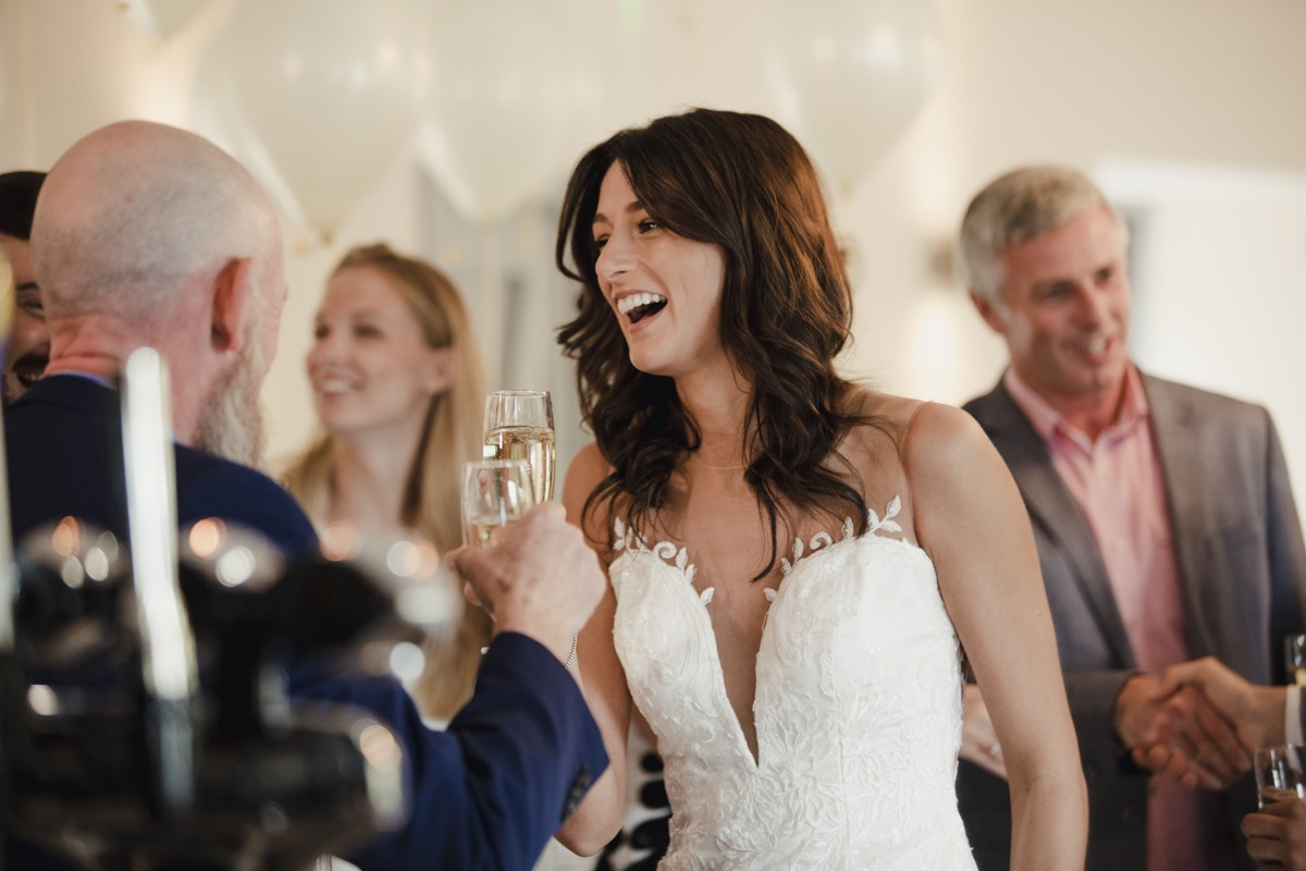 wedding couple greeting guest separately