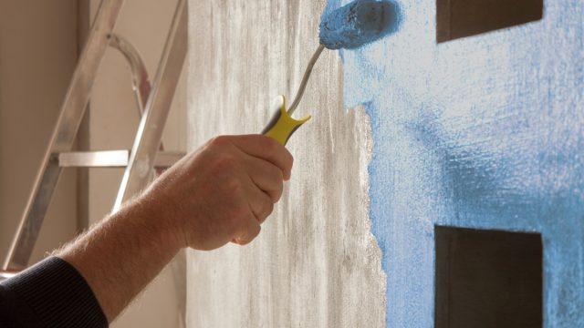 hand painting kitchen wall blue