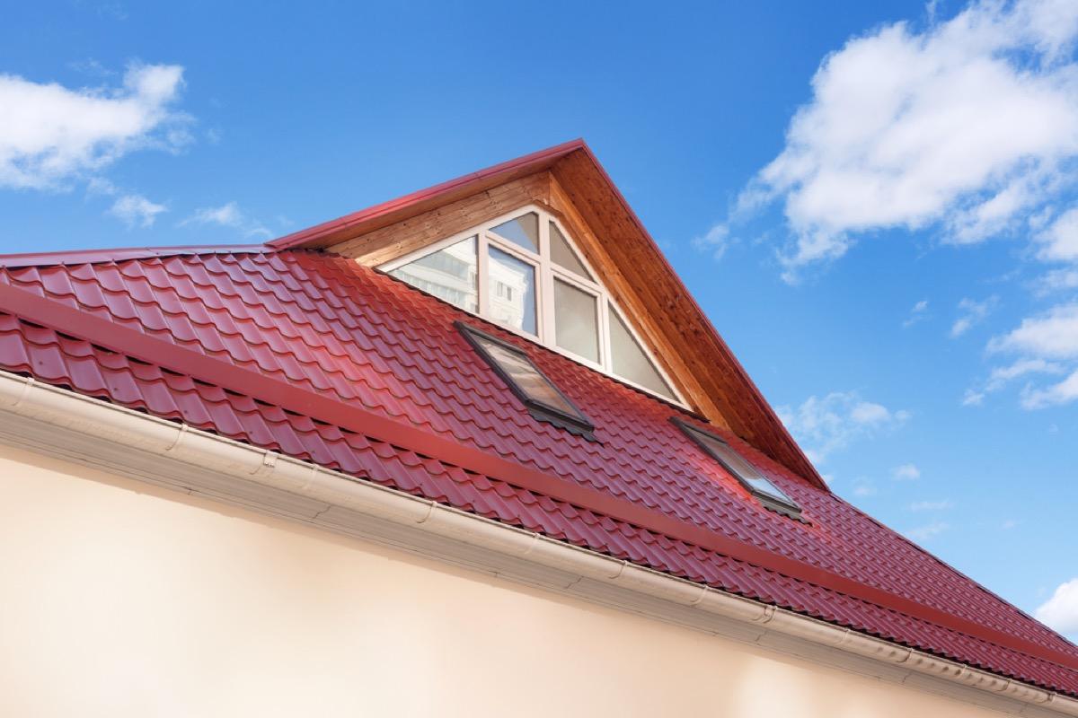 window under roof overhang