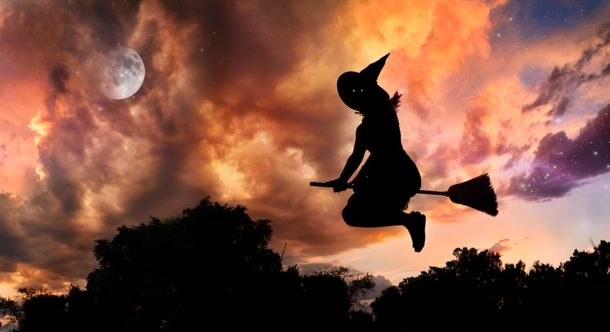 witch silhouette on bright orange sky