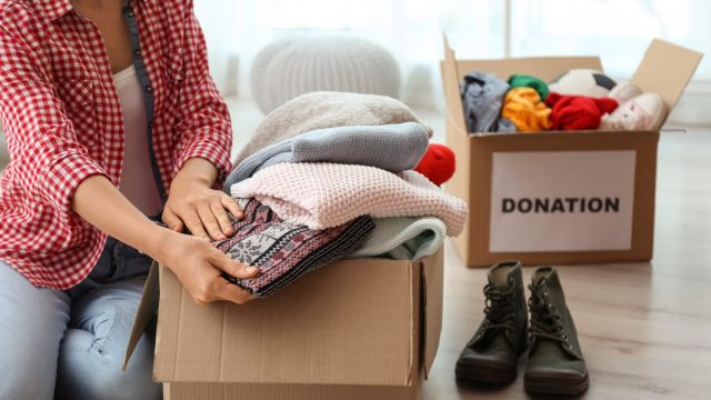 woman clearing out clutter