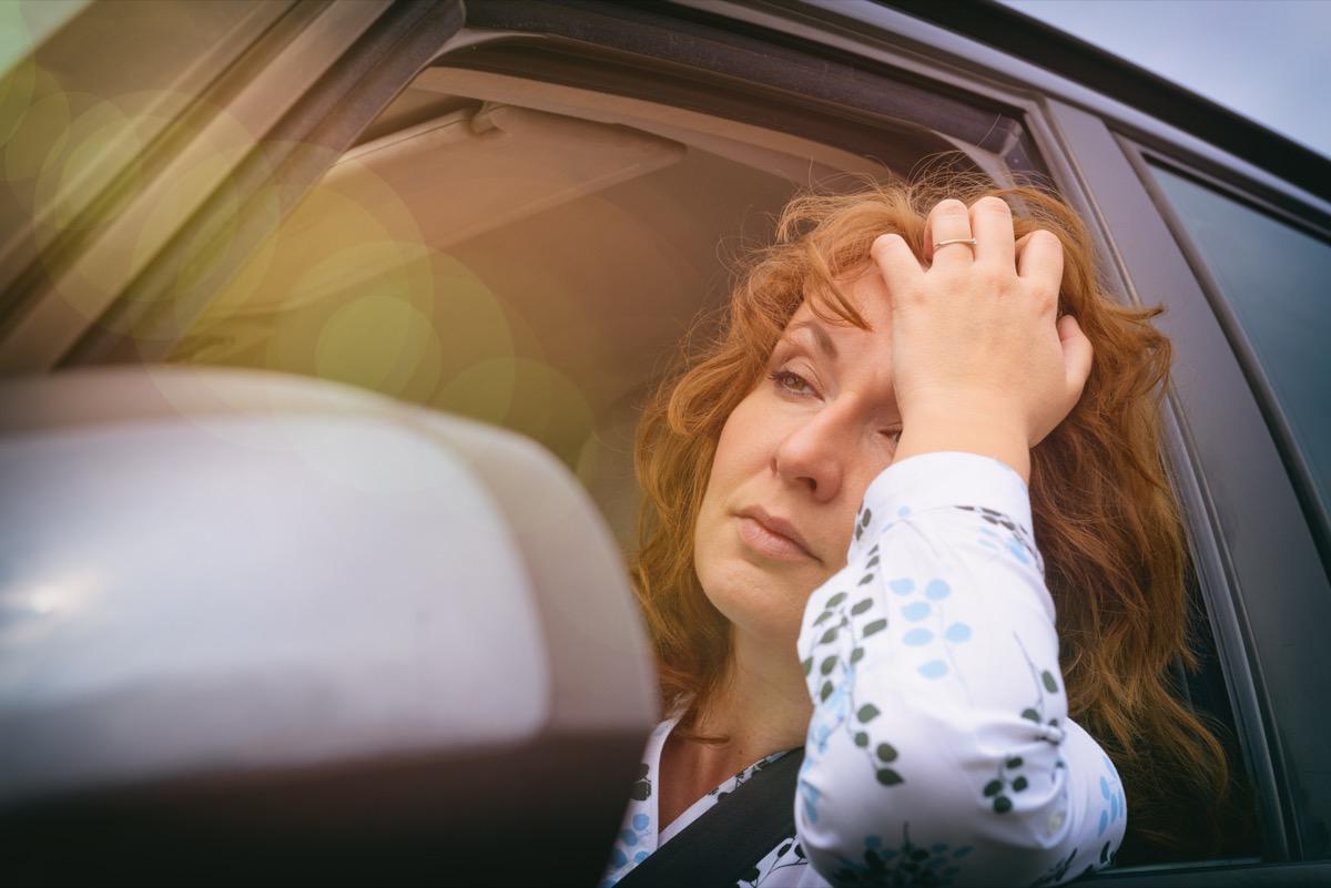 woman unhappy in car