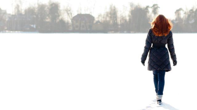 redheaded woman walking in snow