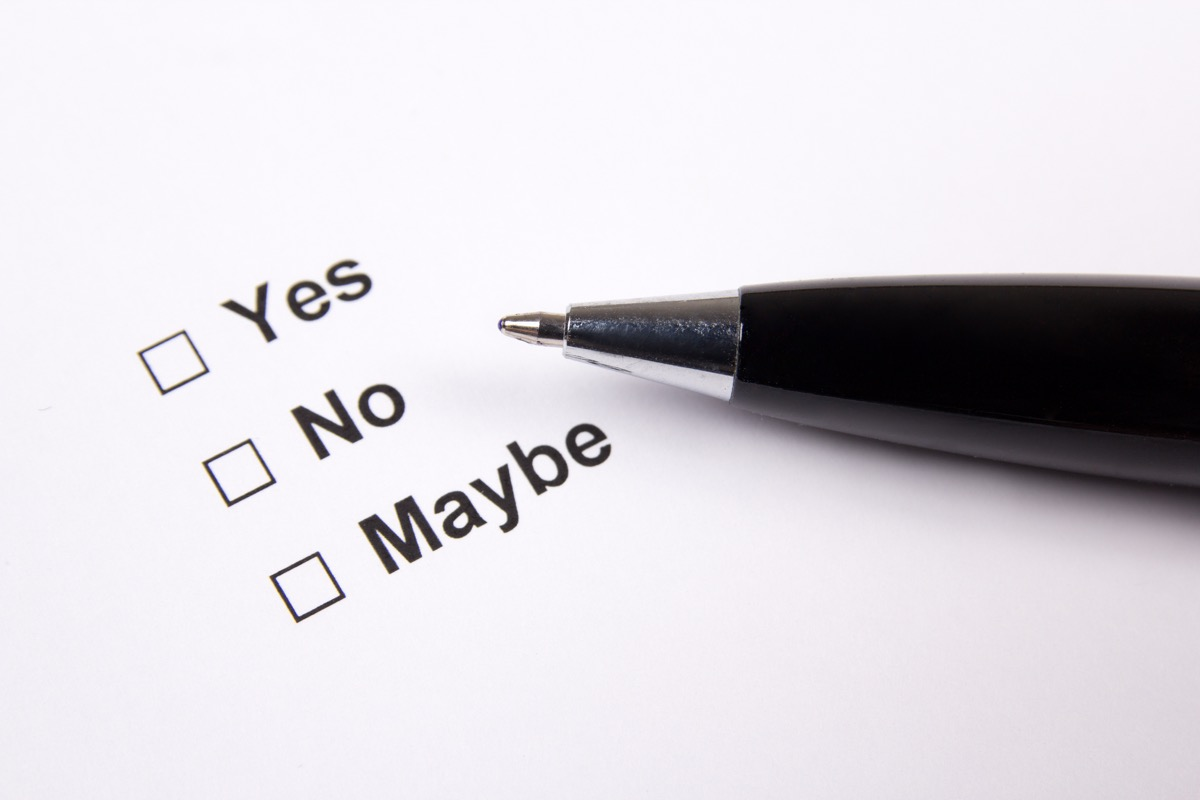 yes no maybe checklist with pen laying atop paper