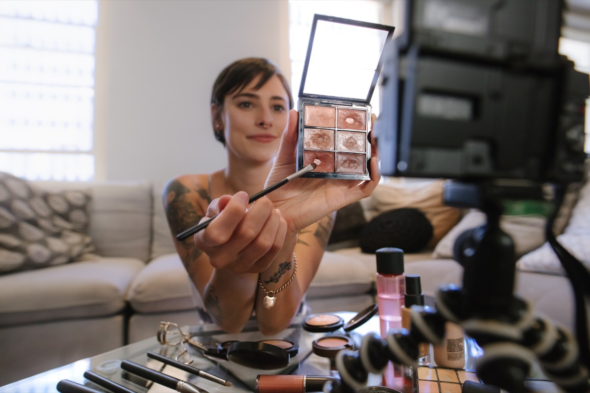 woman making a video about makeup to put on youtube