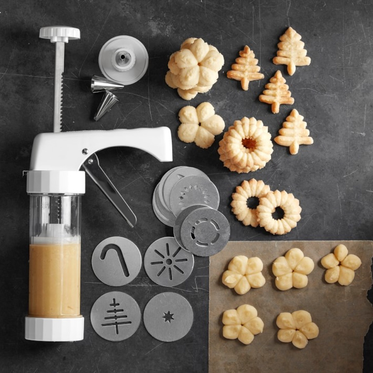 Cookie press with sample cookies