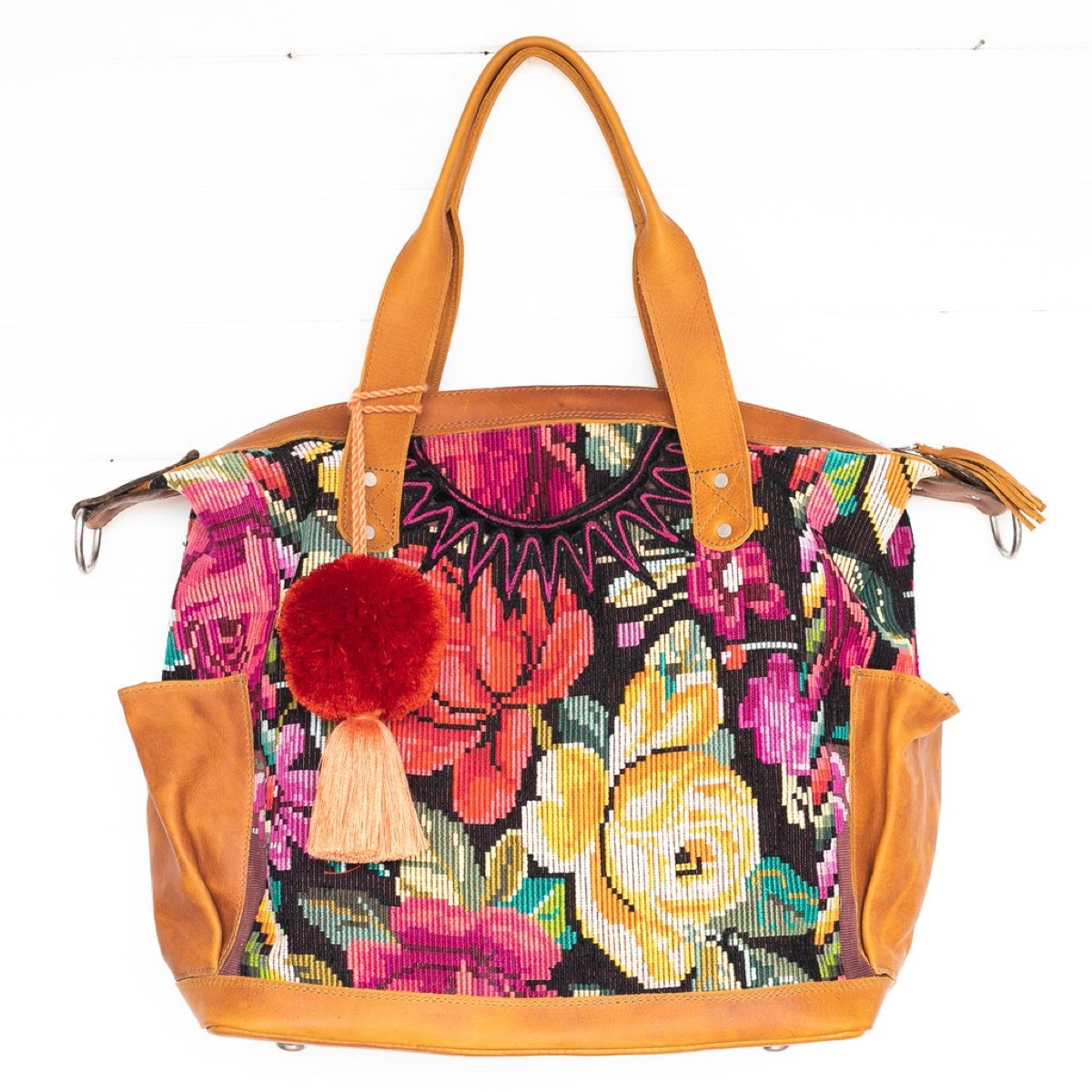 Floral embroidered bag with pom pom