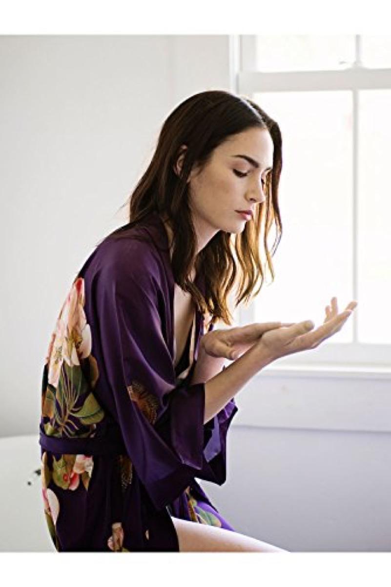 Pretty woman wearing purple robe