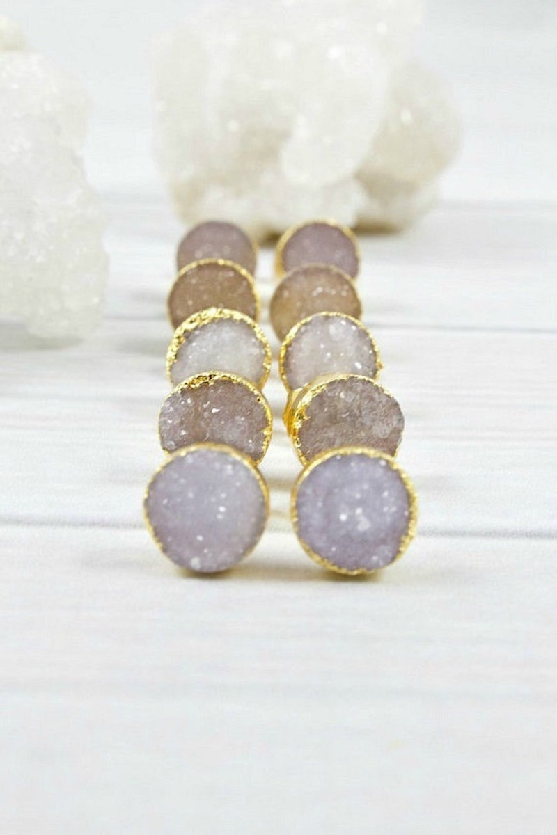 five pairs of pink raw stone earrings