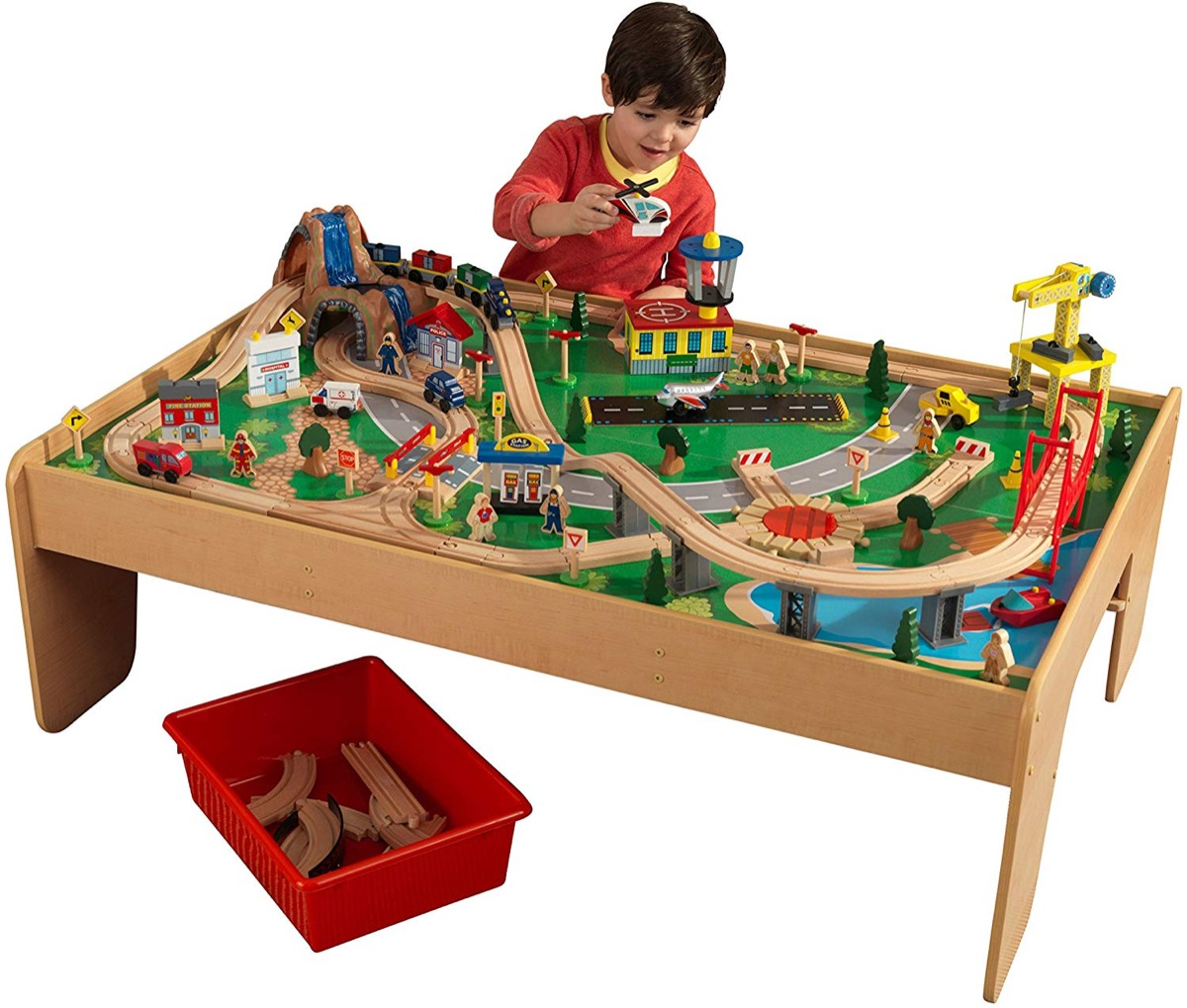 kid playing with wooden train table