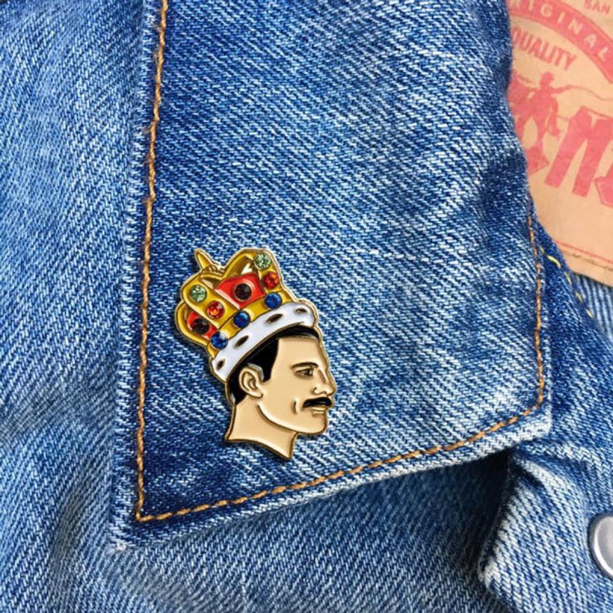 small enamel freddie mercury pin on a jean jacket