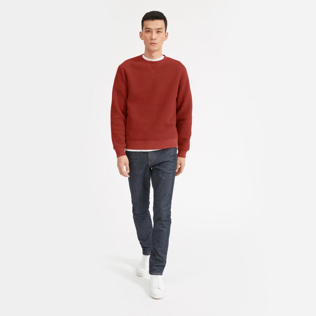 man in red Everlane fleece sweater