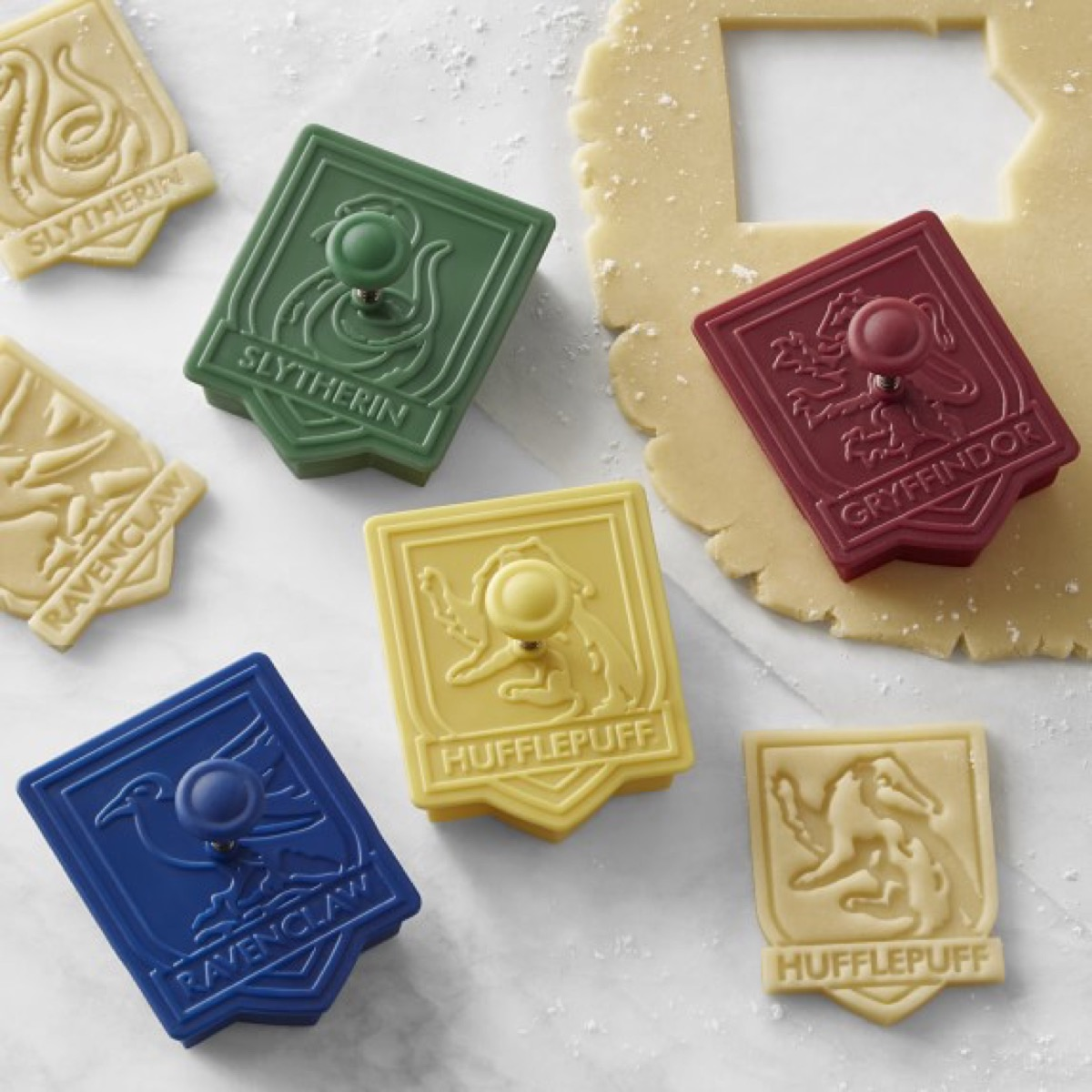 harry potter crest cookie cutters and raw cookie dough