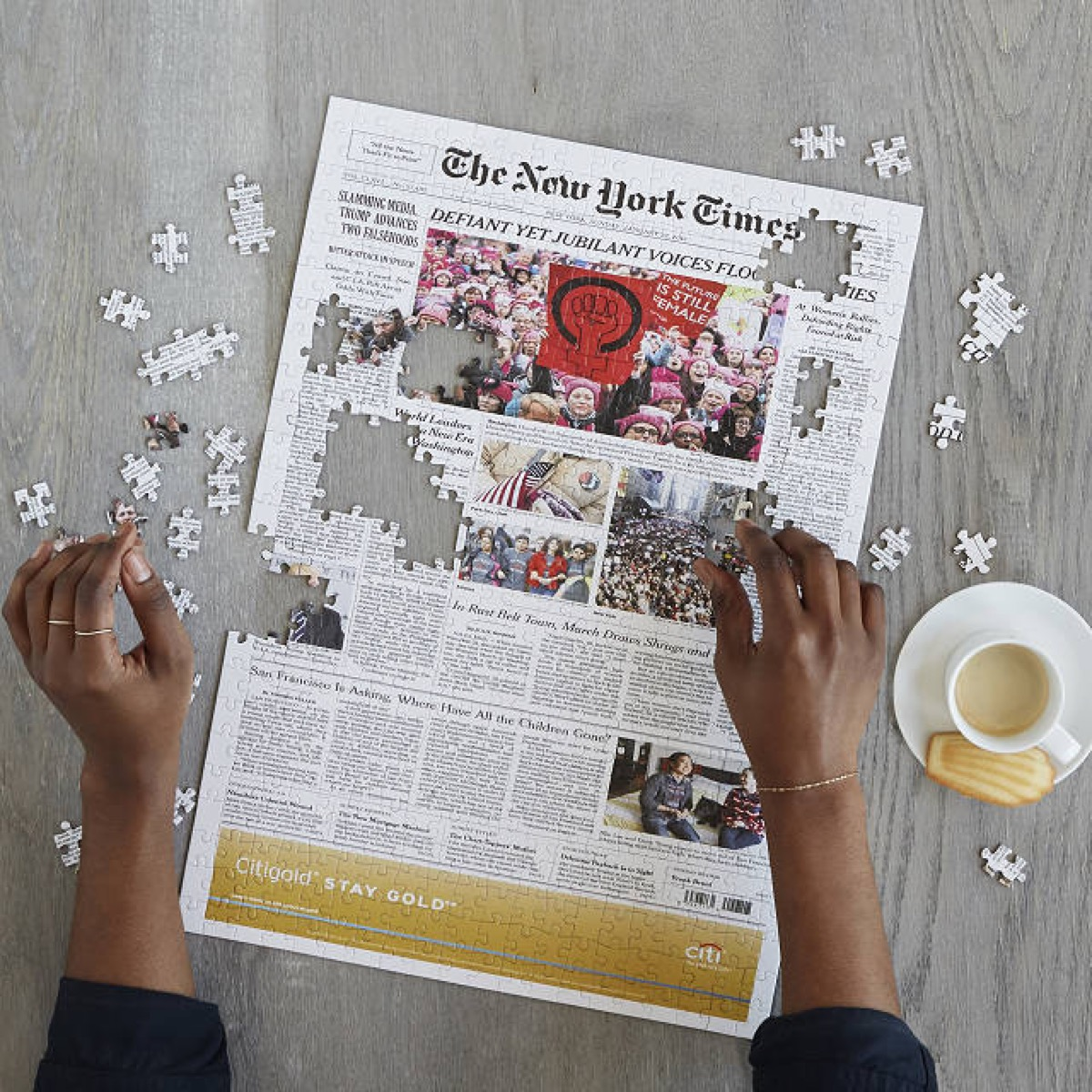 person completing new york times puzzle