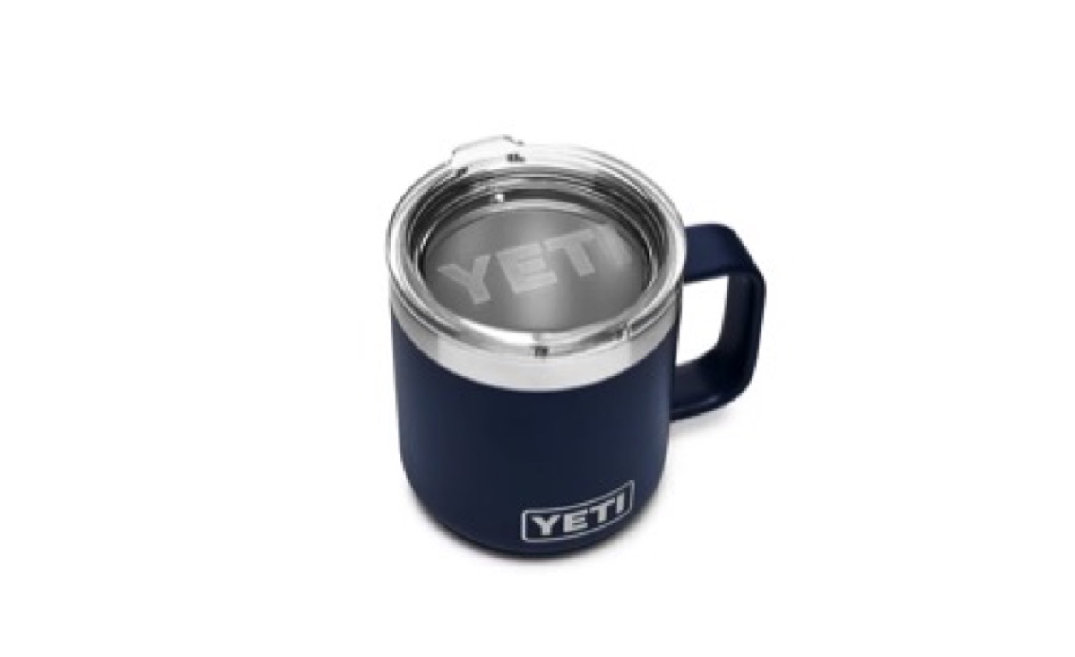 blue yeti rambler mug with silver lid and handle on white background