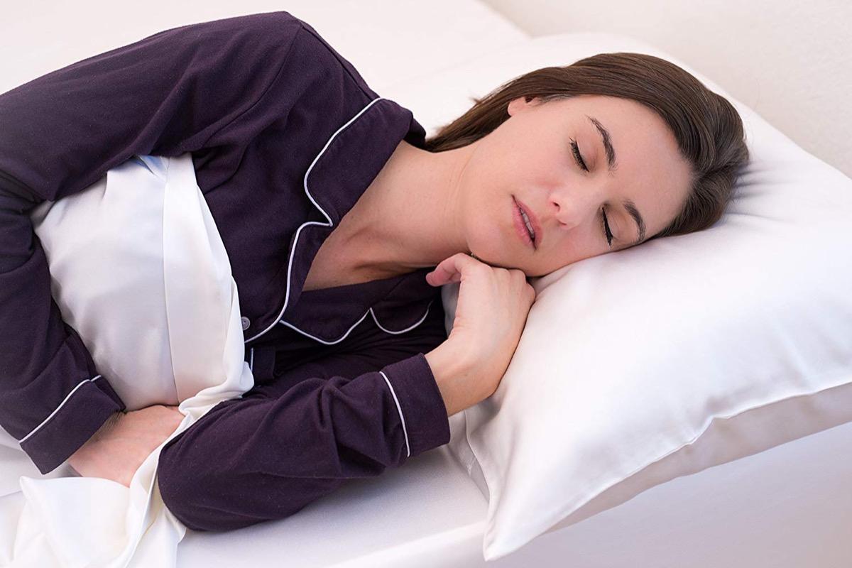 woman sleeping on silk pillowcase