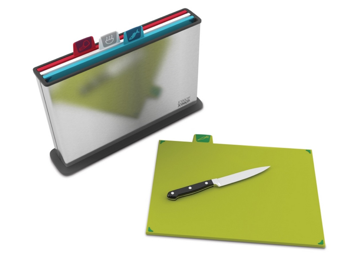 silver file folder with cutting board tabs and knife on green cutting board in front of it