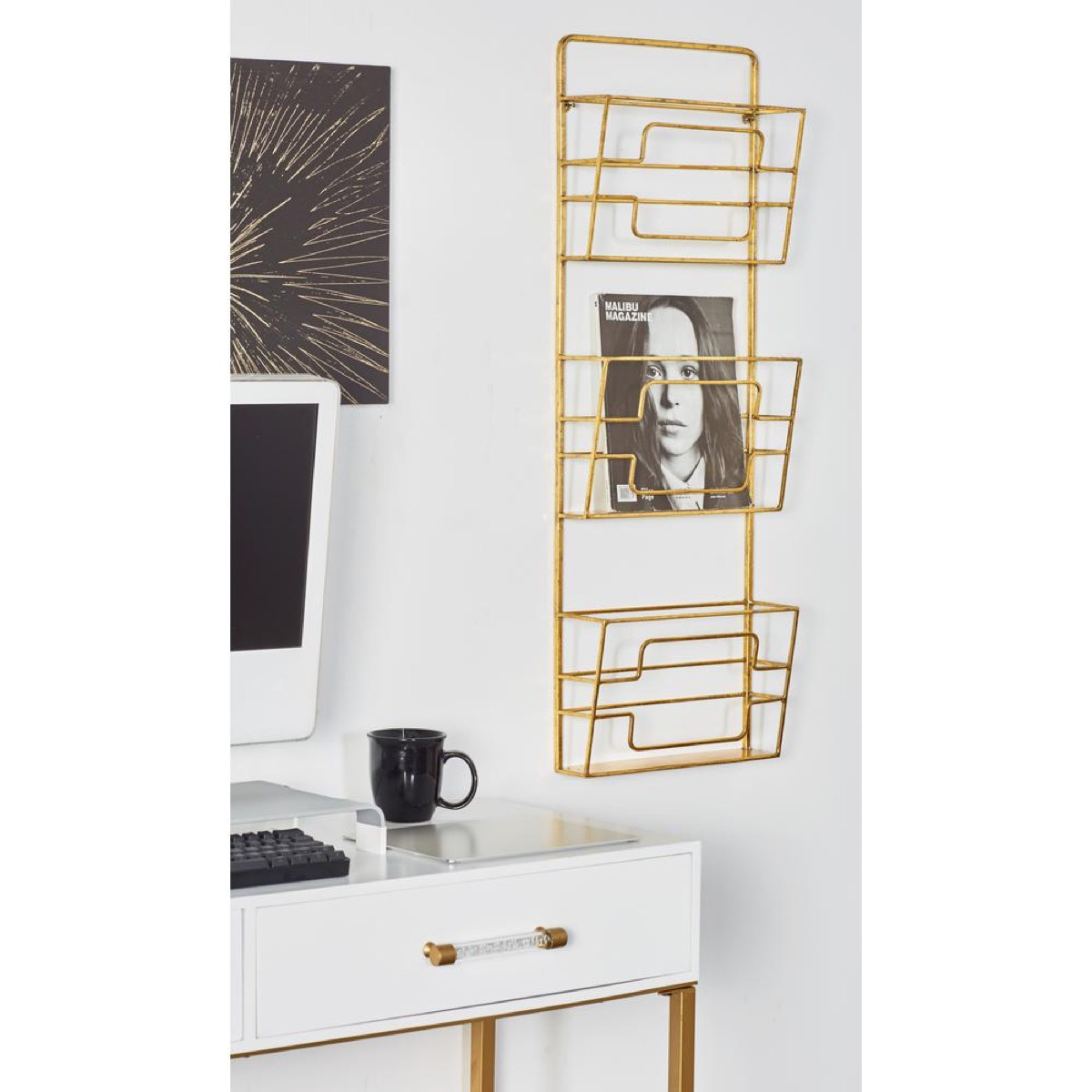 gold magazine rack in home office