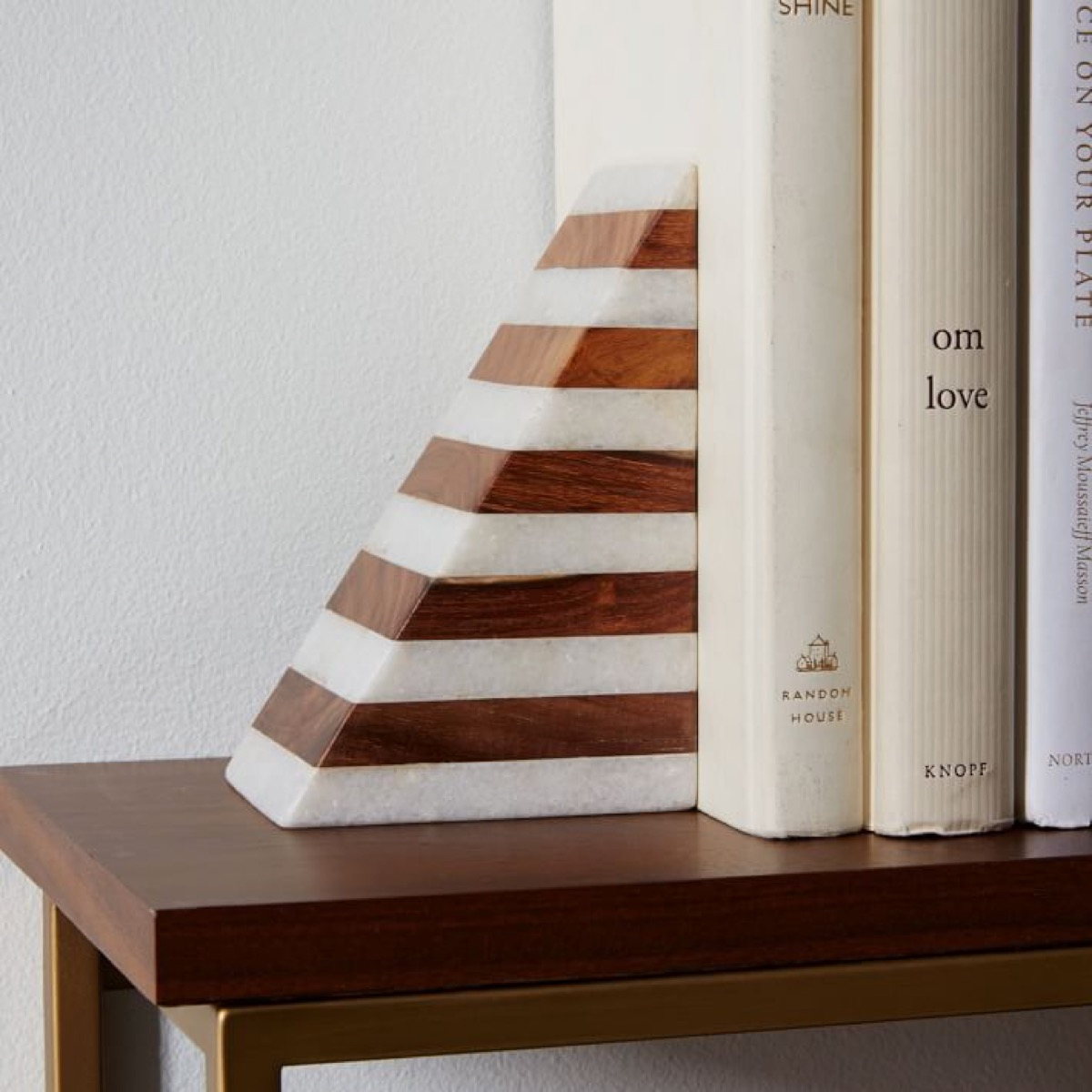 wood and marble book end holding books
