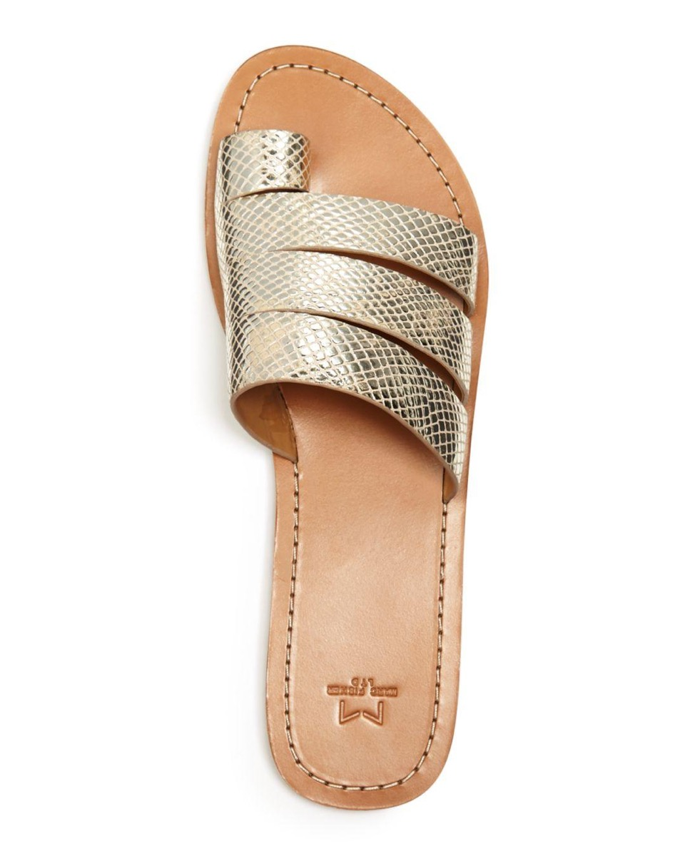 gold stap sandals white background
