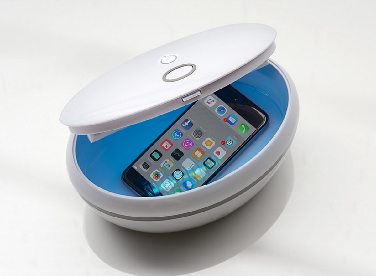 white sanitizing bowl with iphone in it