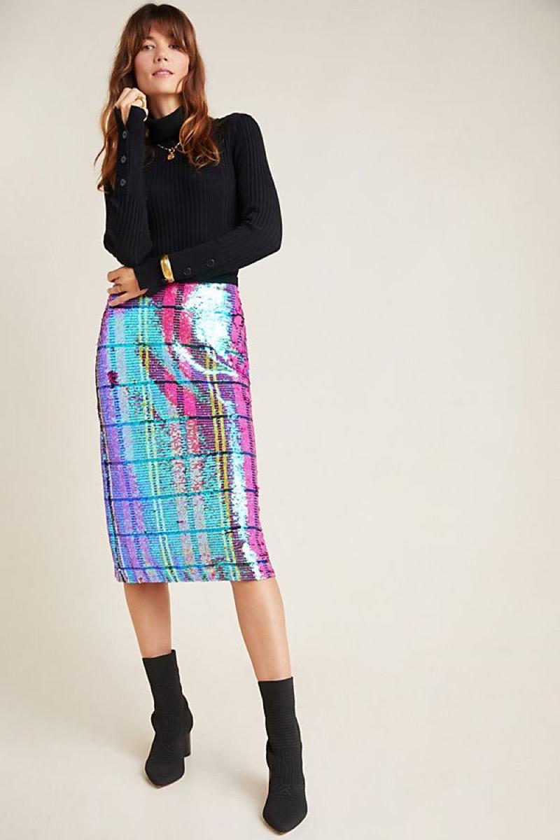 Stylish woman in iridescent skirt