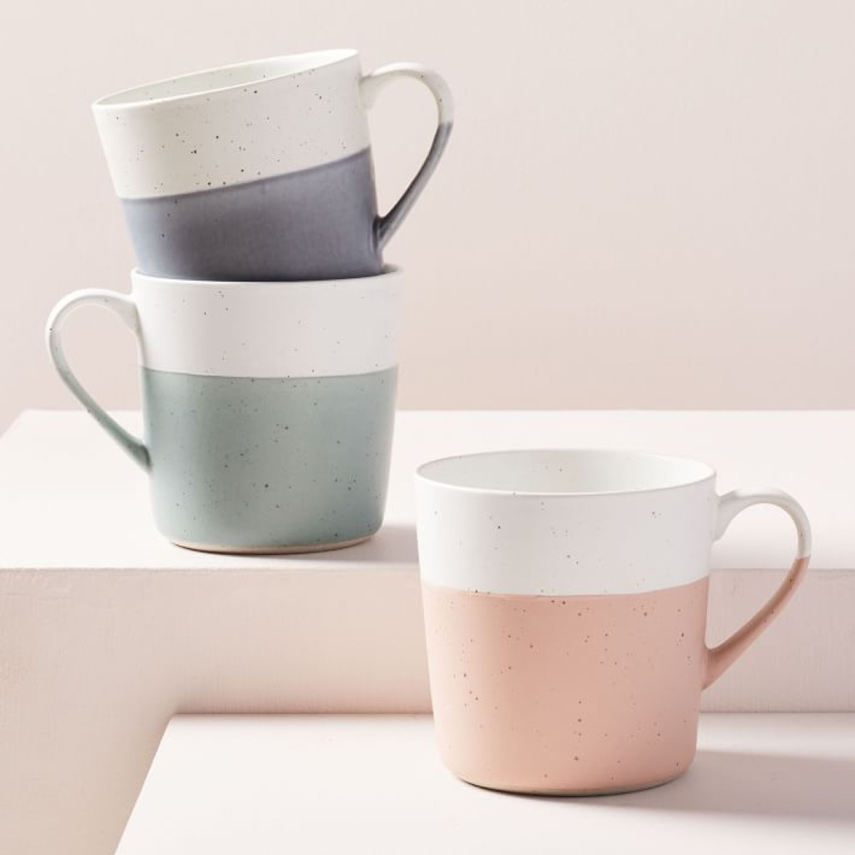 three color blocked speckled mugs in blue green and pink