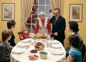 1970s THREE GENERATION FAMILY HAVING THANKSGIVING DINNER