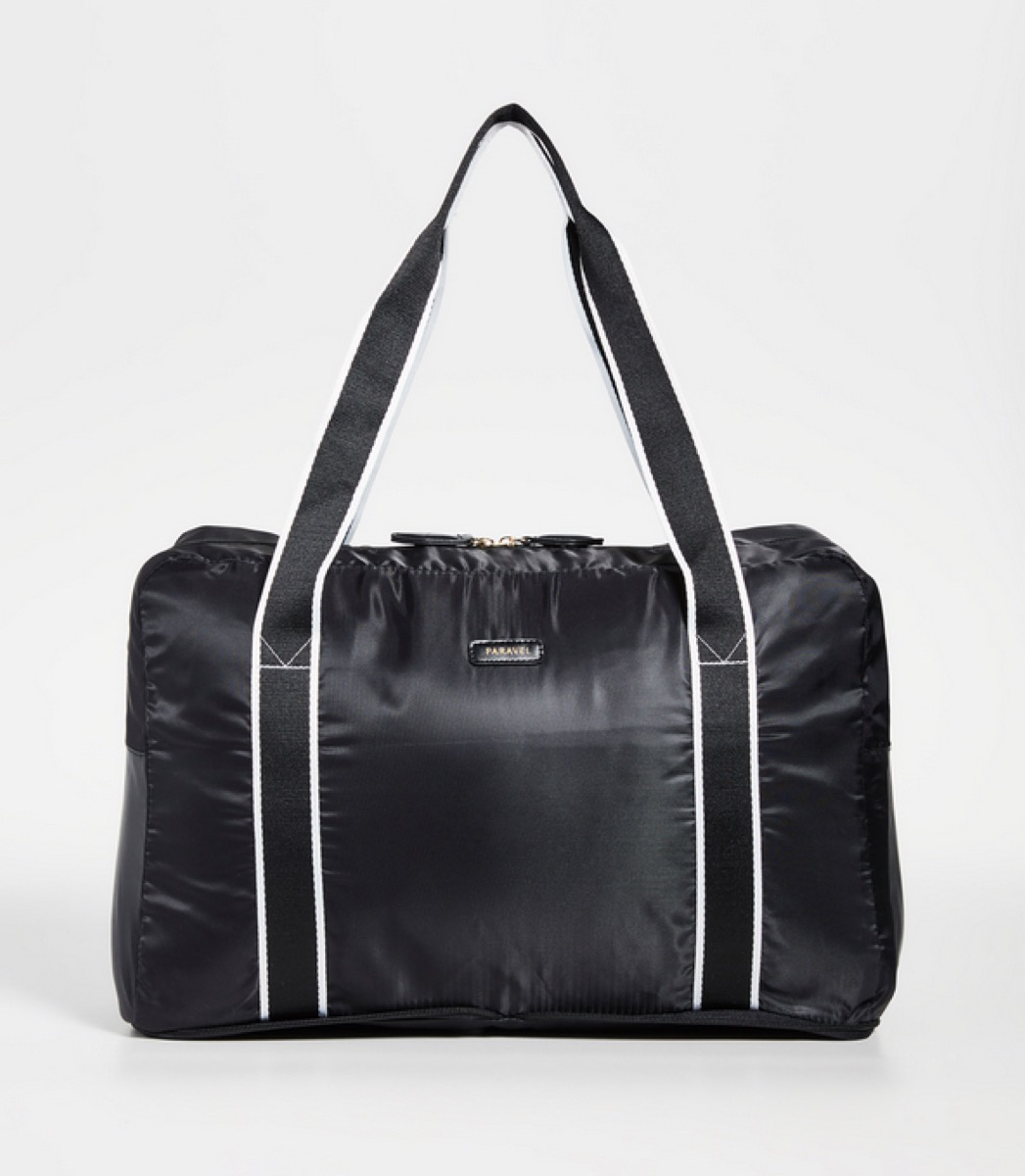 black duffel bag with black and white straps